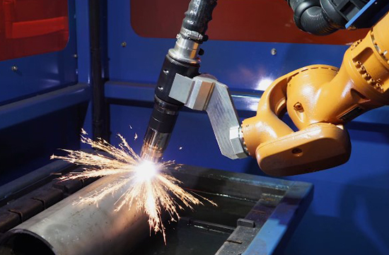 kuka robotic arm with hypertherm cutting torch creating 3d plasma cuts with Flexfab